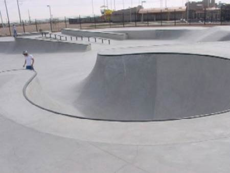 2. The skateboarder carving the bowl